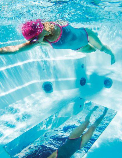 Endless Pools_2019_X200-Lifestyle-AlpineWhite_Woman-Underwater-Mirror_024